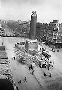 The top of Nelson's Pillar in O'Connell Street was destroyed by a bomb in the early hours of the morning. Dublin Corporation workmen clearing the rubble which was scattered around the base of the pillar..08.03.1966
