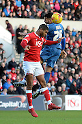 Bristol City defender Mark Little beats Birmingham City midfielder David Davis to a header during the Sky Bet Championship match between Bristol City and Birmingham City at Ashton Gate, Bristol, England on 30 January 2016. Photo by Alan Franklin.