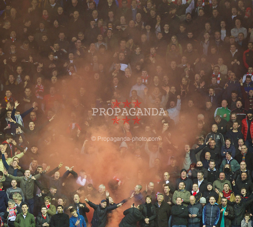 WIGAN, ENGLAND - Saturday, March 2, 2013: Liverpool's supporters celebrate the first goal against Wigan Athletic with a red smoke bomb during the Premiership match at the DW Stadium. (Pic by David Rawcliffe/Propaganda)