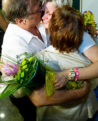 Urska Zolnir hugs her mother Majda and father Ljubo during reception of Slovenian Olympic team, on August 5, 2012 in Airport Joze Pucnik, Brnik, Slovenia. (Photo by Vid Ponikvar / Sportida.com)