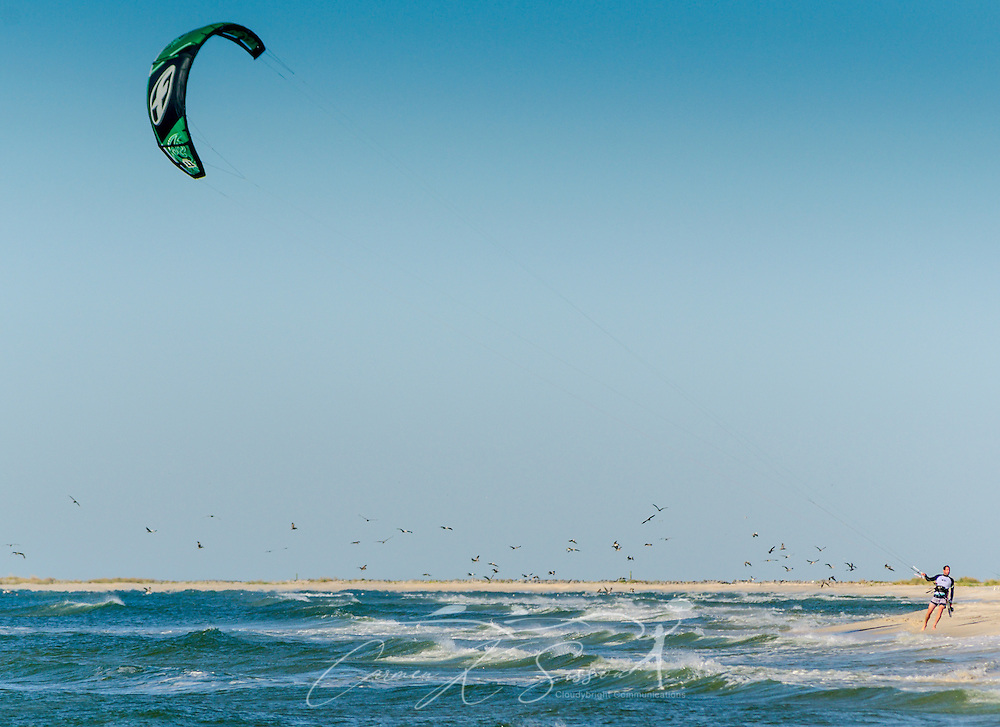 Mathieu Junco returns to shore after a morning of kitesurfing with a F-One Delta C-shaped Bandit Six kite, October 18, 2015, in Dauphin Island, Alabama. Junco, from France, began kitesurfing five years ago. Windy conditions on the island brought surfers out in droves, but many, like Junco, found that the brisk northerly winds made kitesurfing challenging on the south side of the island. Kitesurfing began in France in the 1980's and became a mainstream water sport in 1999, combining aspects of wakeboarding, windsurfing, surfing, and paragliding. More than 1.5 million people participate in the global sport. (Photo by Carmen K. Sisson/Cloudybright)