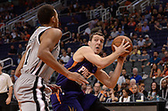 Oct 16, 2014; Phoenix, AZ, USA; Phoenix Suns guard Goran Dragic (1) handles the ball against the San Antonio Spurs guard Kyle Anderson (1) in the first half at US Airways Center. Mandatory Credit: Jennifer Stewart-USA TODAY Sports