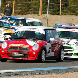 KNOCKHILL Scottish Motor Racing Club meeting..close first lap racing in race 2 for Celtic Speed scottish mini cooper cup..(c) STEPHEN LAWSON | StockPix.eu