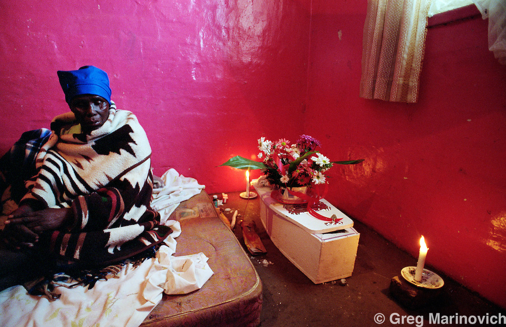 Boipatong, Vaal, Transvaal, South Africa. 1992. The aunt of Aaron Mathope holds vigil over his body ahead of the funeral of 41 people killed by IFP supporters in June 1993.