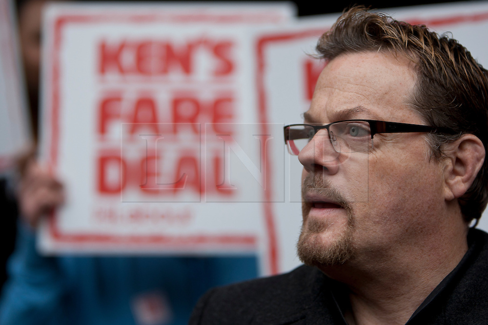 "© licensed to London News Pictures. London, UK 14/03/2012. Eddie Izzard is pictured with ""Ken's Fare Deal"" sign as Ed Miliband and Ken Livingstone launching Labour's London election pledges for this year's mayoral election, outside London Bridge Station, today (14/03/12). Photo credit: Tolga Akmen/LNP"