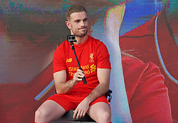 LIVERPOOL, ENGLAND - Monday, May 9, 2016: Liverpool's captain Jordan Henderson with a GoPro and selfie stick at the launch of the New Balance 2016/17 Liverpool FC kit at a live event in front of supporters at the Royal Liver Building on Liverpool's historic World Heritage waterfront. (Pic by David Rawcliffe/Propaganda)
