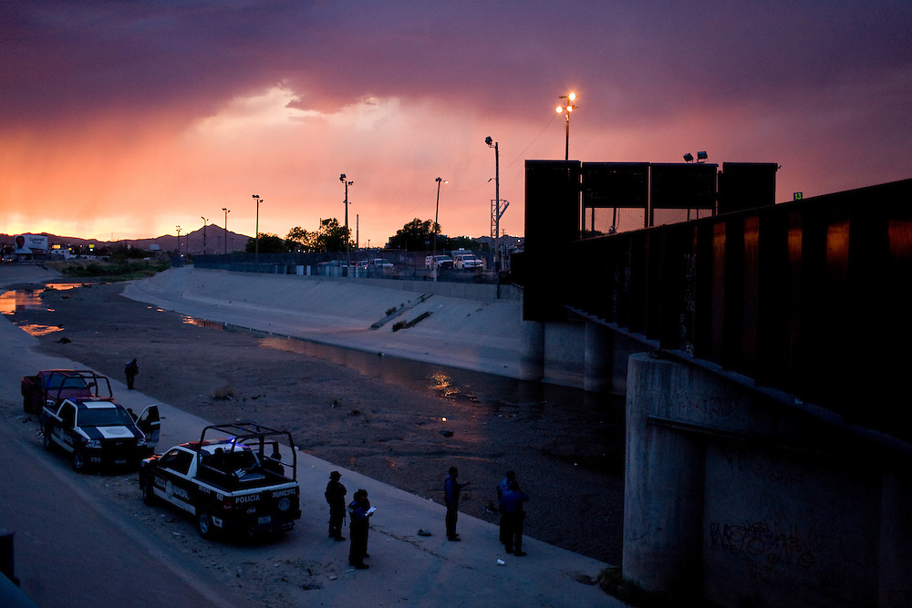 Mexican Federal and Municipal Police at the scene of the shooting of a 15 year-old boy, who was killed by a U.S. Border Patrol agent in Ciudad Juarez, Chihuahua on June 7, 2010 after he had tried to cross.