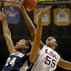 November 16, 2011; Baton Rouge, LA; LSU Tigers forward LaSondra Barrett (55) rebounds over Georgetown Hoyas forward Amanda Reese (24) during the second half of a game at the Pete Maravich Assembly Center. LSU defeated Georgetown 51-40. Mandatory Credit: Derick E. Hingle-US PRESSWIRE