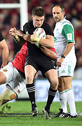 Beauden Barrett of New Zealand held in a Lions tackle in the third International rugby test match between the the New Zealand All Blacks and British and Irish Lions at Eden Park, Auckland, New Zealand, Saturday, July 08, 2017. Credit:SNPA / Ross Setford  **NO ARCHIVING""