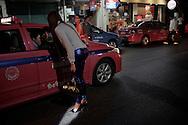 Flagging a taxi. Bangkok, Thailand.