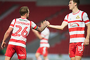 Doncaster Rovers Midfielder James Coppinger (26) & Doncaster Rovers Defender Joe Wright (15) shake hands at the end the The FA Cup match between Doncaster Rovers and Scunthorpe United at the Keepmoat Stadium, Doncaster, England on 3 December 2017. Photo by Craig Zadoroznyj.