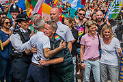 The march is started by Mayor Sadiq Khan (hugging an ambulance woman), LGBt members of the emergency services, Justin Greening MP and a gay London authority mayor - The annual London Gay Pride march heads from Oxford Circus to Trafalgar Square.