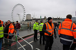© Licensed to London News Pictures. 31/12/2016. London, UK. Westminster Bridge in London being closed of by security and police officers ahead of tonight's New Year celebrations. Security surrounding this year's event has been heightened following a terrorist attack at a Christmas market in Berlin earlier this month. Photo credit: Ben Cawthra/LNP