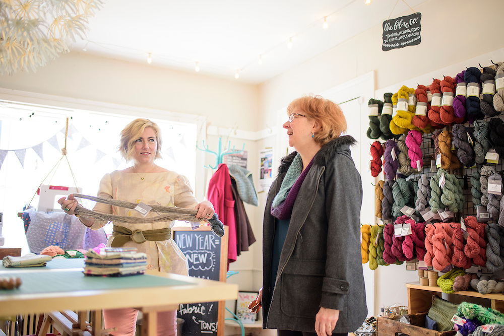 Leesburg, Virginia - February 13, 2017: Nicole Morgenthau, owner of Finch Knitting + Sewing Studio in Leesburg, Va., helps Laura Sinner, 65, from Shepherdstown, W.Va., Monday February 13, 2017.<br /> <br /> In January Morganthau received a Pro-Trump email threatening a boycott of her store. She posted the note on her store's Facebook page. The response was an outpour of support for Morganthau and an increase in business.<br /> <br /> <br /> CREDIT: Matt Roth for The New York Times<br /> Assignment ID: 30202692A