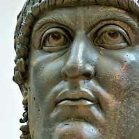Colossal of Constantine Bronze Head at Capitoline Museums in Rome, Italy <br /> Constantine I was called Constantine the Great for several reasons. Prior to becoming a Roman Emperor he was a successful military leader in several civil wars. During his reign from 306 to 337, he was the first ruler to embrace Christianity.  He also established Constantinople (modern Istanbul in Turkey) as a Roman capitol city. During the next 800 years it would grow to become Europe&rsquo;s richest city. This mammoth bronze sculpture of his head is from the 4th century. It is displayed in the Capitoline Museums&rsquo; Palazzo dei Conservatori.