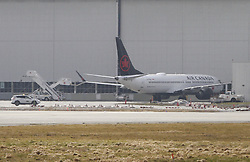 VANCOUVER, March 13, 2019  An Air Canada Boeing 737 Max 8 aircraft is seen at a maintenance building at Vancouver International Airport in Richmond, Vancouver, Canada, March 13, 2019. Canada is grounding all its Boeing 737 Max 8 and 9 aircraft and banning the jets from its airspace following the Ethiopian Airlines crash that killed all 157 people on board, including 18 Canadians. (Credit Image: © Liang Sen/Xinhua via ZUMA Wire)