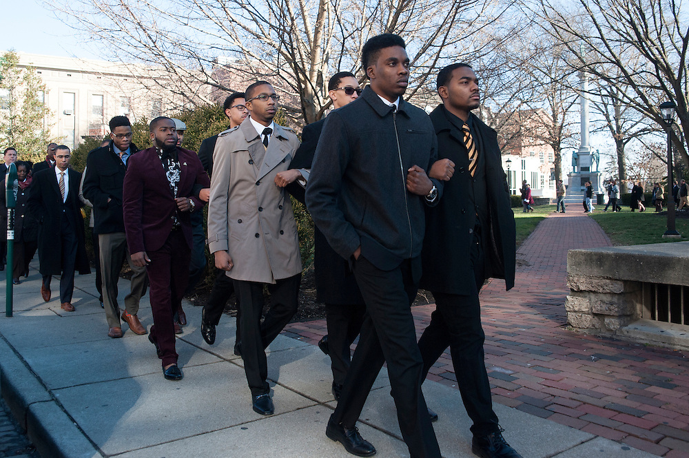 Jerry Mobley, Tyrin Rome, William E. Johnson and other members of the Phi Chapter of Alpha Phi Alpha fraternity lead members of the Athens Community in a Silent Walk in honor of Martin Luther King Jr. on Monday, January 19.