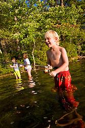 Kids fishing at White Lake State Park in Tamworth, New Hampshire.