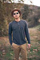 Stylish man in mid-20s with hat and sunglasses,