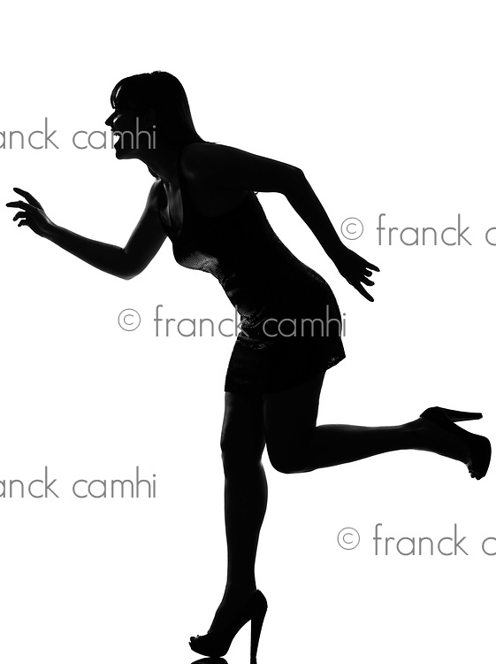 stylish silhouette caucasian beautiful woman running happy full length on studio isolated white background