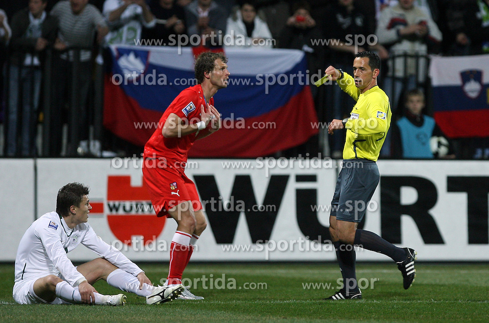 David Rozenhal of Czech Republic gets yellow card from referee Pedro Proenca Oliveira Alves Garcia, L sitting Zlatko Dedic of Slovenia at the 8th day qualification game of 2010 FIFA WORLD CUP SOUTH AFRICA in Group 3 between Slovenia and Czech Republic at Stadion Ljudski vrt, on March 28, 2008, in Maribor, Slovenia. Slovenia vs Czech Republic 0 : 0. (Photo by Vid Ponikvar / Sportida)