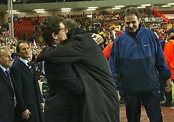 LIVERPOOL, ENGLAND - Tuesday, March 19, 2002: Liverpool's manager Gerard Houllier is embraced by AS Roma manager Fabio Capello as he returns to the touchline after recovering from a heart attack, during the UEFA Champions League Group B match against AS Roma at Anfield. (Pic by David Rawcliffe/Propaganda)