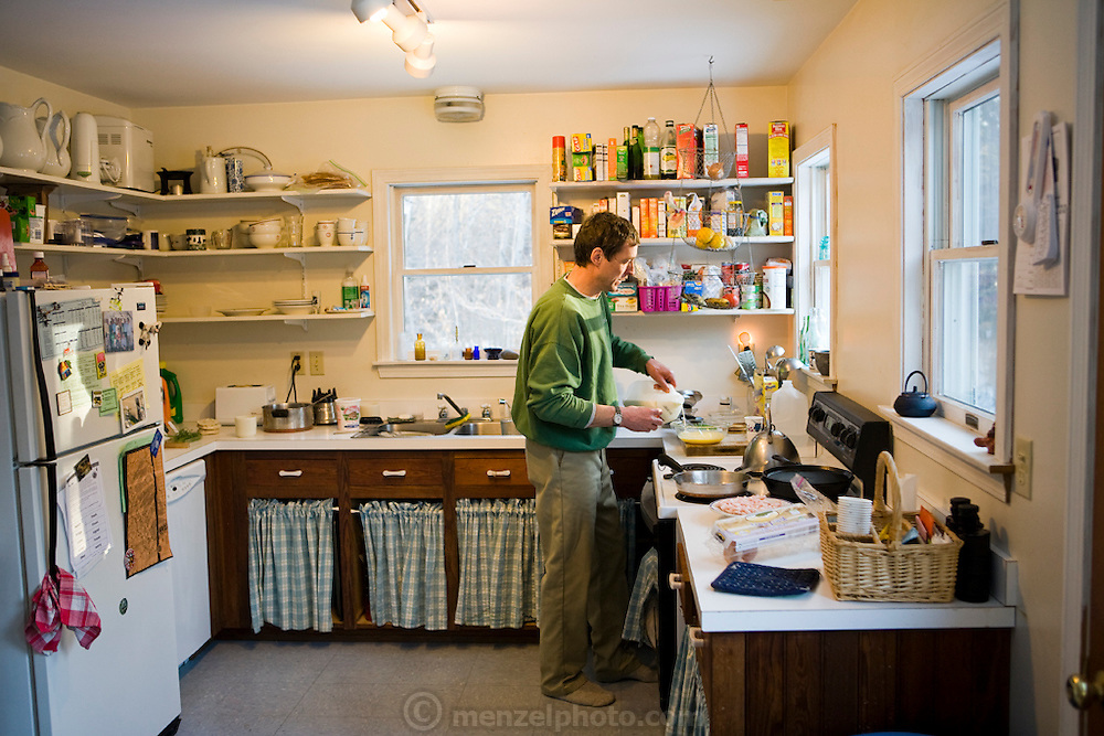 Lobsterman and fish buyer Sam Tucker makes pancakes at his home on Great Diamond Island, Maine. (Samuel Tucker is featured in the book What I Eat: Around the World in 80 Diets.) MODEL RELEASED