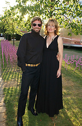 STEFANO PILATI and JULIA PEYTON-JONES at the Serpentine Gallery Summer party sponsored by Yves Saint Laurent held at the Serpentine Gallery, Kensington Gardens, London W2 on 11th July 2006.<br />