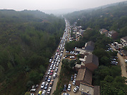 XI'AN, CHINA - SEPTEMBER 16: <br /> <br /> Aerial view of tourists cars parking on a provincial road at a studio city on September 16, 2016 in Xi\'an, Shaanxi Province of China. Tourists vehicles parked along a provincial road which made the road a long parking lot during the Mid-Autumn Festival holiday. <br /> ©Exclusivepix Media