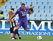Udine, 18 Settembre 2011.Campionato di calcio Serie A 2011/2012  3^ giornata..Udinese vs Fiorentina. Stadio Friuli..Nella Foto:  Basta colpito al volto da Pasqual..© foto di Simone Ferraro