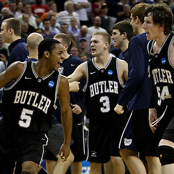 Mar 26, 2011; New Orleans, LA; Butler Bulldogs guard Ronald Nored (5) and forward Matt Howard (54) celebrate following a win over the Florida Gators in the semifinals of the southeast regional of the 2011 NCAA men's basketball tournament at New Orleans Arena. Butler defeated Florida 74-71.  Mandatory Credit: Derick E. Hingle