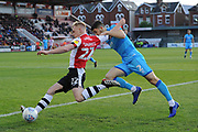 Jack Sparkes (22) of Exeter City battles for possession with Sean Long (2) of Cheltenham Town during the EFL Sky Bet League 2 match between Exeter City and Cheltenham Town at St James' Park, Exeter, England on 16 November 2019.