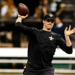 Oct 26, 2014; New Orleans, LA, USA; New Orleans Saints quarterback Drew Brees (9) warms up before a game against the Green Bay Packers at the Mercedes-Benz Superdome. Mandatory Credit: Derick E. Hingle-USA TODAY Sports