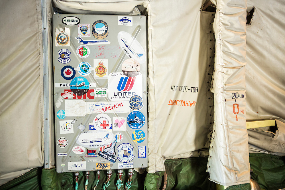 GOSTOMEL, UKRAINE - OCTOBER 1, 2014: Stickers decorate a panel inside the Antonov AN-225, the longest and heaviest airplane ever built, which is parked on an airfield in Gostomel, outside Kiev, Ukraine. CREDIT: Brendan Hoffman for The New York Times