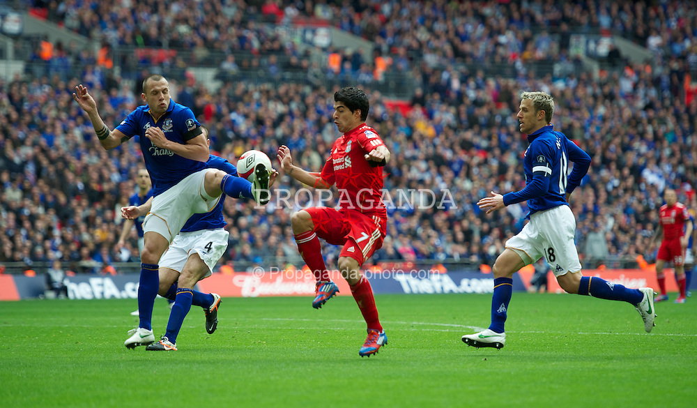 LONDON, ENGLAND - Saturday, April 14, 2012: Liverpool's Luis Alberto Suarez Diaz and Everton's John Heitinga during the FA Cup Semi-Final match at Wembley. (Pic by David Rawcliffe/Propaganda)