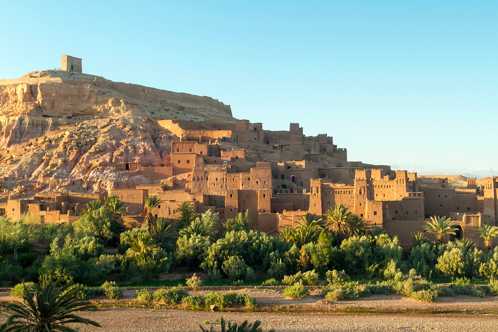 Ait BenHaddou ksar, Ouarzazate, Morocco Morocco, 2014-04-24.<br /><br />The ancient ksar (group of fortified kasbah's) of Ait ben Haddou is a UNESCO World Heritage Site and has been used as a location set for many blockbuster films including The Mummy (1999), Gladiator (2000) and Babel (2006). It stands at one side of the Ounila Valley along the old caravan route from Marrakesh to the Sahara.<br /><br />The Ounila Valley links the Tizi n Tichka pass to Ait Ben Haddou and was originally the main thoroughfare for the trans-saharan trade route between Marrakesh and sub-saharan Africa. Today, evidence of this once highly important role is reflected in the numerous crumbling kasbah's and ksar which are dotted all throughout the valley. <br /><br />The famous ksar of Ait ben Haddou stands at one entrance to the valley (Ouarzazate direction) while the Telouet Kasbah of Thami El Glaoui – once Pasha of Marrakesh and the southern regions – stands at the other (just before the road links back up to the N9 highway). All the kasbah's and ksar inside the valley were built by families of high status and would have had the privilege of receiving gifts from across the world as a sort of tax for using the road.