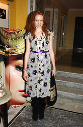 Model LILY COLE at the launch of MAC's High Tea collection with leading British designers held at The Berkeley Hotel, London on 17th January 2005.  MAC has collabroated with The Berkeley's Pret-a-Portea, which adds a creative twist to th classic elements of the English afternoon tea with cakes and pastries inspired by fashion designs.<br /><br />NON EXCLUSIVE - WORLD RIGHTS