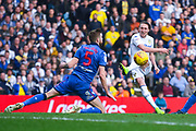 Luke Ayling of Leeds United (2) shoots as Mark Beevers of Bolton Wanderers (5) blocks during the EFL Sky Bet Championship match between Leeds United and Bolton Wanderers at Elland Road, Leeds, England on 23 February 2019.