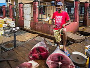 08 OCTOBER 2017 - NEGOMBO, WESTERN PROVINCE, SRI LANKA: A fish monger selling yellowfin tuna in Negombo, north of Colombo. Fish is an important source of protein for many Sri Lankans.    PHOTO BY JACK KURTZ