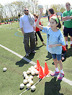 NEWTOWN, PA - APRIL 26:  Tiffany Belinski, of Yardley, Pennsylvania throws a softball during a Special Olympics Track and Field Meet at Council Rock North High School April 26, 2014 in Newtown, Pennsylvania. Over 600 athletes competed at the high school. (Photo by William Thomas Cain/Cain Images)