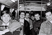 Group of friends at the back of the bus, UK, 1987.