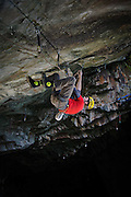 """Simon Chevis attempting an ascent of the hard dry tooling route """"Blood Line""""at Hodge Close Quarry, Lake District, UK"""