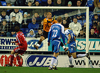 Photo: Paul Greenwood.<br />Wigan Athletic v Liverpool. The Barclays Premiership. 02/12/2006. Wigan's Paul Scharner, right, scores past Liverpool keeper Jose Reina