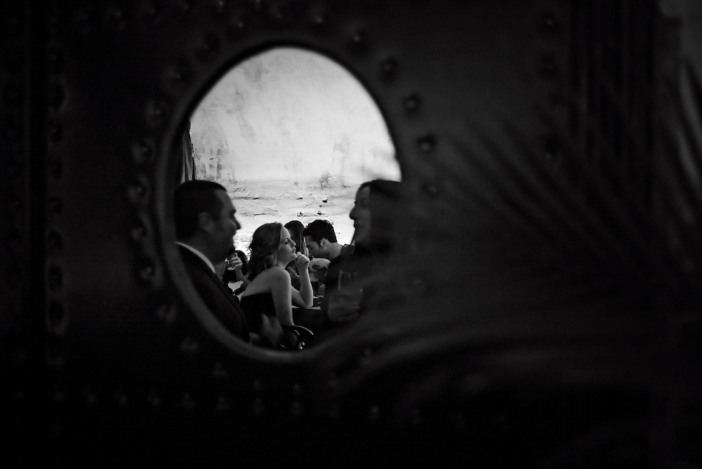 People seen reflected in mirror at bar, New York, NY, US
