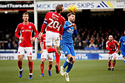 Charlton midfielder Chris Solly (20) and Peterborough Utd forward Matthew Godden (9) challenge for this header during the EFL Sky Bet League 1 match between Peterborough United and Charlton Athletic at London Road, Peterborough, England on 26 January 2019.
