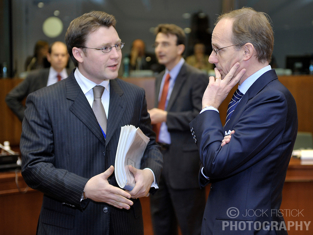 Luc Frieden, Luxembourg's minister of Finance, right, speaks with a colleague during ECOFIN, the meeting of EU finance ministers, at the European Council headquarters in Brussels, Belgium, on Tuesday, Nov. 10, 2009. (Photo © Jock Fistick)
