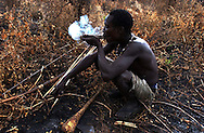 Yaeda Valley, Tanzania: Hoya, a Hadzabe man, enjoys a break from hunting and gathering. He is smoking marijuana, part of a culture that dates back at least 60,000 years. He lit his pipe with a fire made from rubbing sticks together. There are fewer than 1,500 Hadzabe hunter gatherers left on Earth, all living in this corner of Northern Tanzania near the Serengeti Plains. (PHOTO: MIGUEL JUAREZ LUGO)