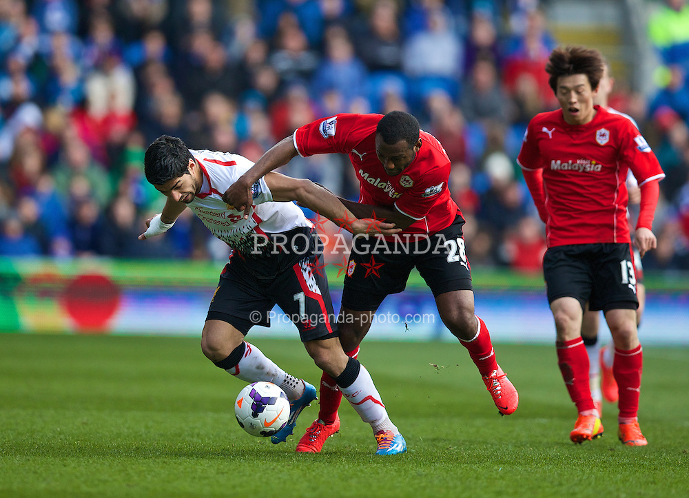CARDIFF, WALES - Saturday, March 22, 2014: Liverpool's Luis Suarez in action against Cardiff City's Kevin Theophile-Catherine during the Premiership match at the Cardiff City Stadium. (Pic by David Rawcliffe/Propaganda)