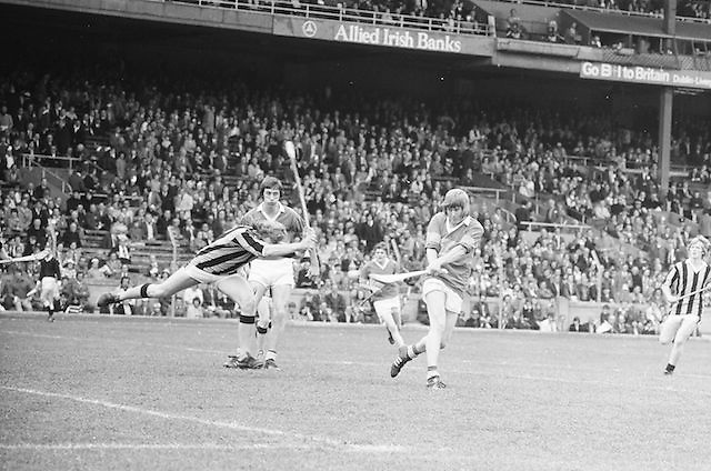 Tipperary takes a shot at the goal as Kilkenny smashes his hurl down in an attempt to block it during the All Ireland Minor Hurling Final, Tipperary v Kilkenny in Croke Park on the 5th September 1976.