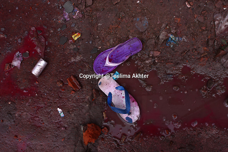 Tear shell, colored water from water cannon and abandoned sandals are the witness of the atrocities that have been lashed out over the workers. .30th June, 2010, Dhaka, Bangladesh.